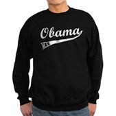 Support President Barack Obama w/ this collegiate-sports style design. Obama is spelled out in classic cursive text w/ '12 inside the long trailing swish. Support Obama's re-election with unique swag.